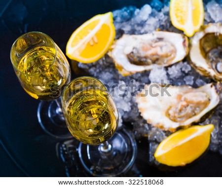 beautiful appetizer oysters and alcohol two glasses wine champagne luxury life background studio food - stock photo