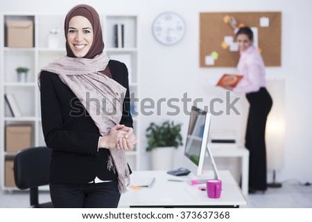 Beautiful Arabic business woman working  in her office,focus on arabic woman - stock photo