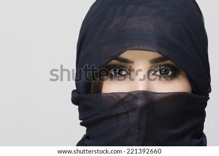beautiful arabic woman in hijab with bright makeup - stock photo