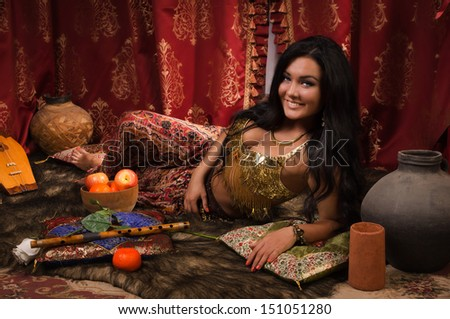Beautiful arabic woman in the arabic harem interior