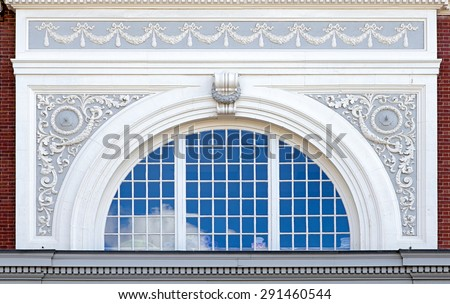 Beautiful arched window with decorative frame