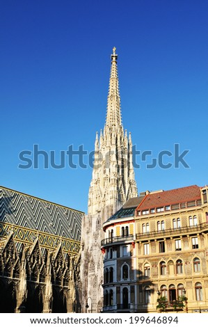 Beautiful architecture of Saint Stephen cathedral against blue sky in Vienna, Austria - stock photo