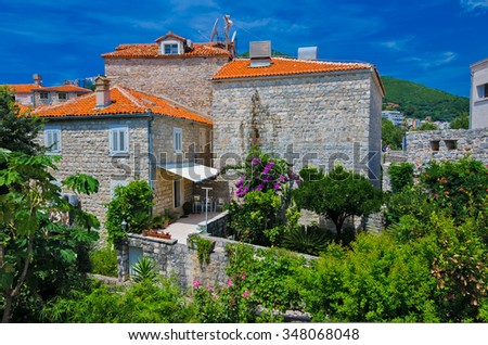 Beautiful architecture. Old houses, windows and tiled roof. Budva, Montenegro - stock photo