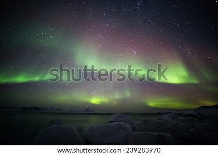 Beautiful Arctic landscape with Northern Lights - Spitsbergen, Svalbard - stock photo