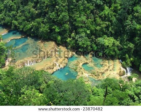 beautiful arial view of turquoise waterfalls in guatemala - stock photo