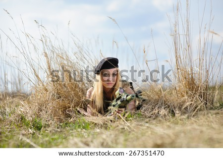 Beautiful army girl with gun  outdoor - stock photo