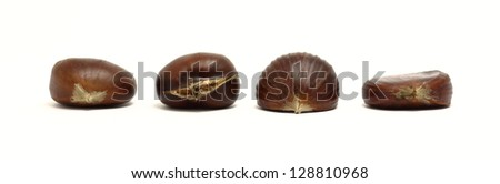 Beautiful arrangement of chestnuts with different structures - stock photo