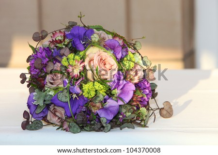 beautiful arrangement of flowers composed of various shades of red, purple, pink and green