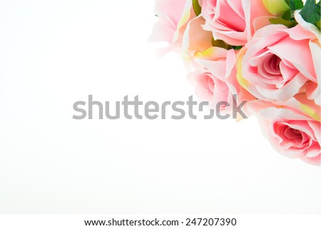 Beautiful artificial pink rose on isolated white background