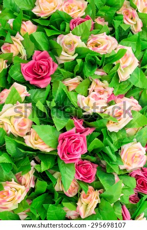 beautiful artificial roses flowers for background.