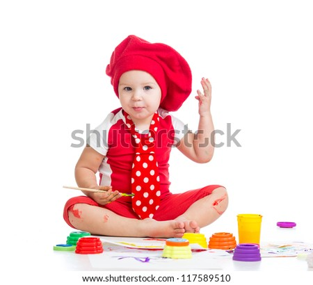 beautiful artist child painting with brush - stock photo