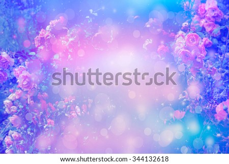 Beautiful artistic background with romantic pink roses in the garden - stock photo