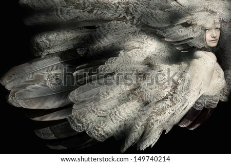 Beautiful artistic portrait of a girl with plumage - stock photo