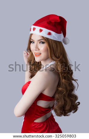 Beautiful asia woman model in Santa Claus clothes - in studio