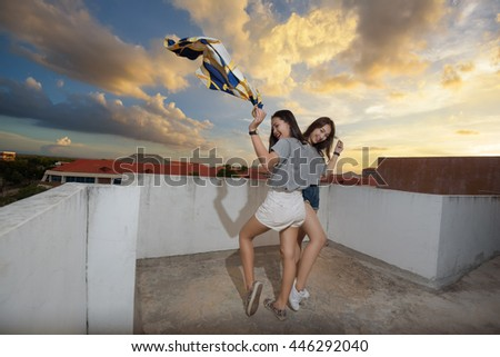 Beautiful asia woman new throwing clothes of smile in twilight - stock photo
