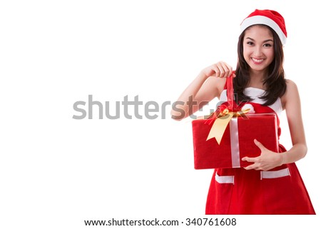 Beautiful Asia woman wear Santa Clause costume, smile and hold new year gift box present, This image already include clipping part and skin retouching - stock photo