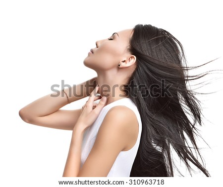 Beautiful asian brunette girl with healthy long hair isolated on a white background. Beauty Brunette Woman - stock photo