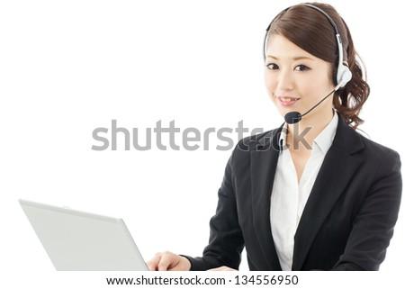 Beautiful asian business operator isolated on white background - stock photo