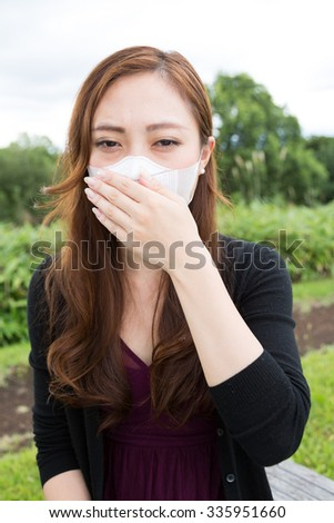 beautiful asian business woman have a cold