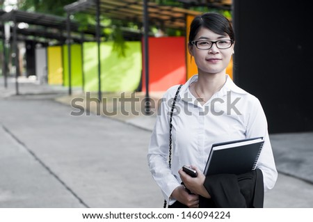 Beautiful Asian business woman in shopping mall.