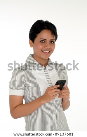 Beautiful asian business woman texting on cell phone