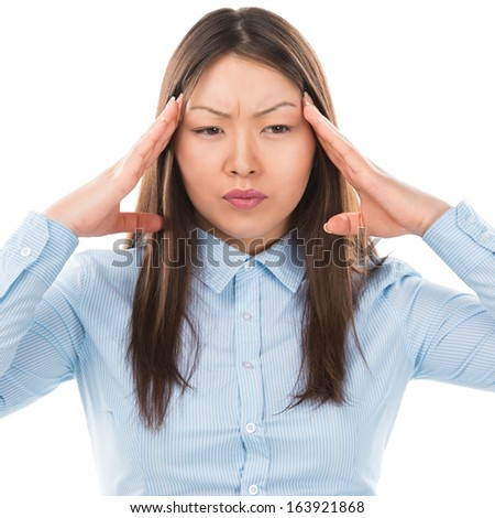 Beautiful Asian business woman with headache holding head in pain over white background - stock photo