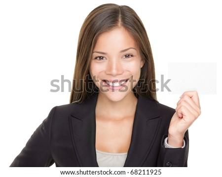 Beautiful Asian businesswoman showing business card. Young confident mixed race Asian / Caucasian woman showing sign with copy space isolated on white background. - stock photo