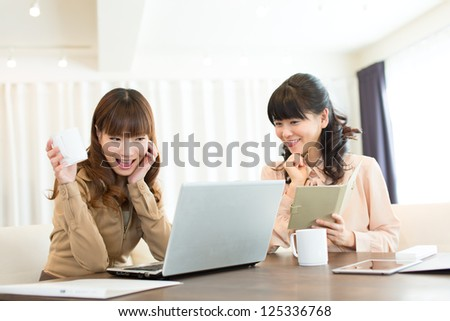 Beautiful asian businesswoman working in office - stock photo