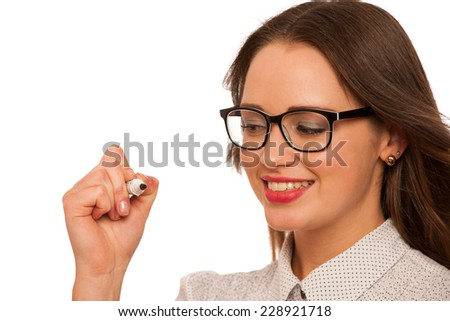 Beautiful asian caucasian woman writing presentation with marker isolated - stock photo