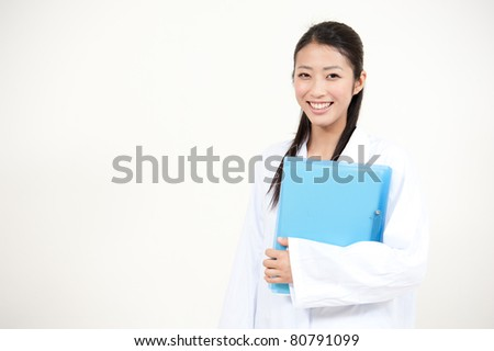 beautiful asian doctor working - stock photo