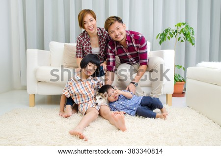 Beautiful asian family enjoying family time at home - stock photo