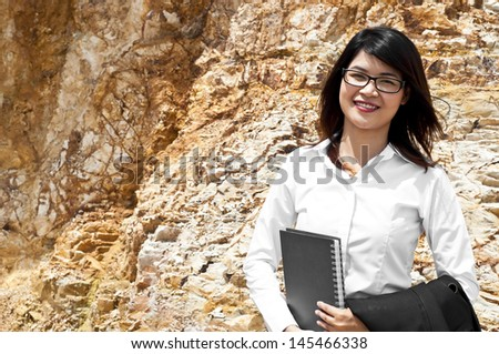 Beautiful Asian geologist researching in stratigraphy.