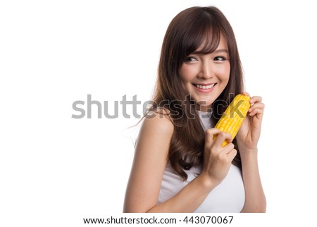 Beautiful asian girl eating corn, isolated on white background