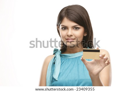 Beautiful asian girl holding a  credit card - stock photo