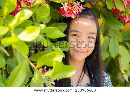 Beautiful Asian girl in a spring garden - stock photo