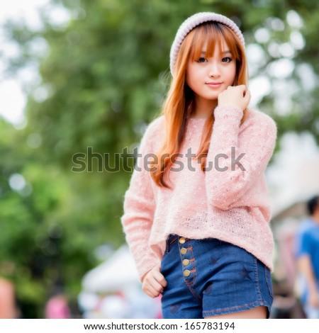 Beautiful asian girl in park  - stock photo