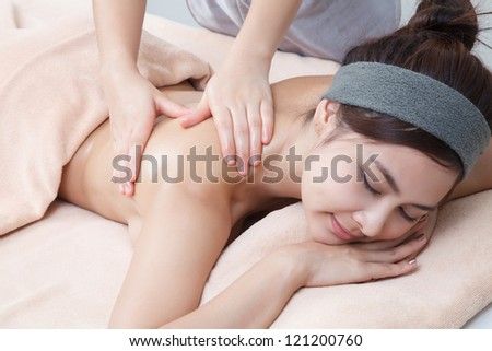 beautiful asian girl in spa on spa bed
