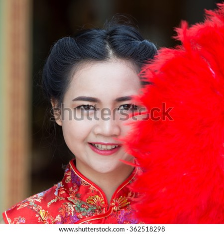 Beautiful asian girl in traditional chinese cheongsam red dress