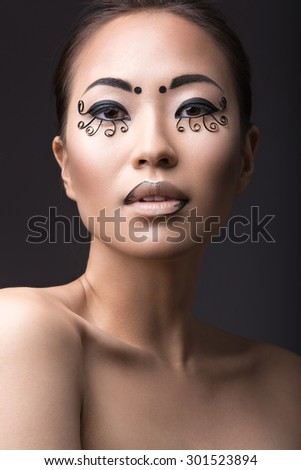 Beautiful Asian girl with a creative makeup, unusual eyelashes paper. Beauty face.  - stock photo