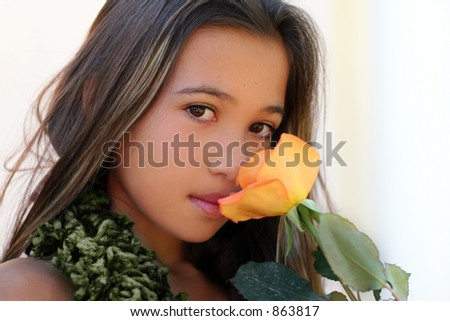 Beautiful asian girl with a rose