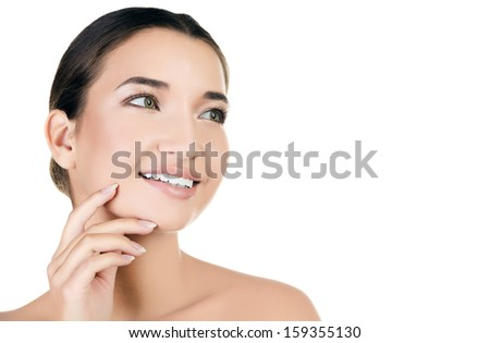 Beautiful asian girl with clean fresh skin, white background, copyspace - stock photo