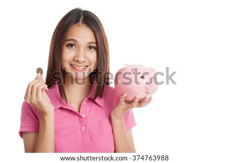 Beautiful Asian girl with piggy bank  isolated on white background