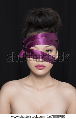 Beautiful Asian girl with Red Ribbon on head - stock photo