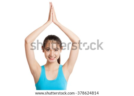 Beautiful Asian healthy girl do yoga pose  isolated on white background