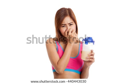 Beautiful Asian healthy girl hate whey protein smell  isolated on white background
