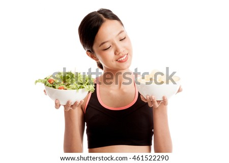 Beautiful Asian healthy girl salad and potato chips  isolated on white background .