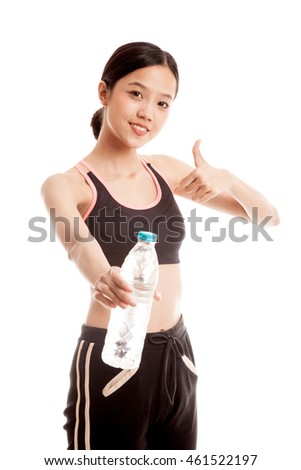 Beautiful Asian healthy girl with bottle of drinking water  isolated on white background .
