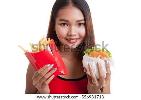 Beautiful Asian healthy girl with french fries and hamburger  isolated on white background.