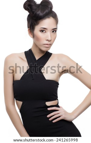 Beautiful Asian look fashion model in black dress on the white background. - stock photo