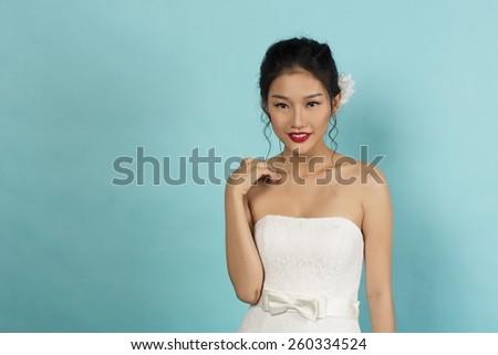Beautiful Asian Oriental Bride in Studio - stock photo